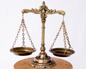 Justice scales by MilousSK on Shutterstock.com