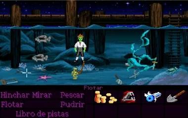 Después de 10 minutos bajo el agua, Guybrush muere. Los verbos cambian y hasta nos sugiere comprar un libro de pistas