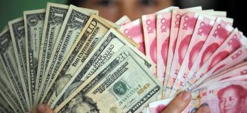 US Dollars and RMB banknotes. (File Photo: Xinhua/IANS)