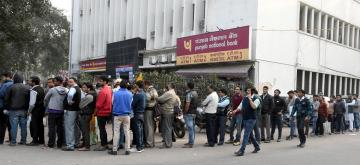 New Delhi: People queue-up outside an ATM in New Delhi on Dec 9, 2016. (Photo: IANS)