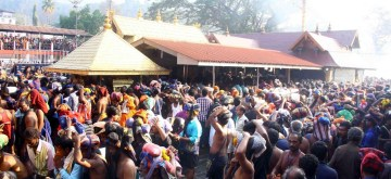 Sabarimala: Devotees throng Sabarimala temple at Pathanamthitta district of Kerala on Dec 26, 2016. At least 40 pilgrims were injured, three of them seriously, in a stampede at the temple (Photo: IANS)