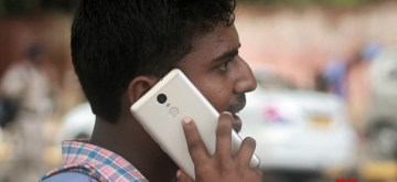 A man talks over cell phone. (File Photo: IANS)