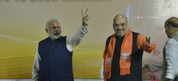 New Delhi: Prime Minister and BJP leaders Narendra Modi and Amit Shah during a party programme in New Delhi on Dec 18, 2017. (Photo: IANS)