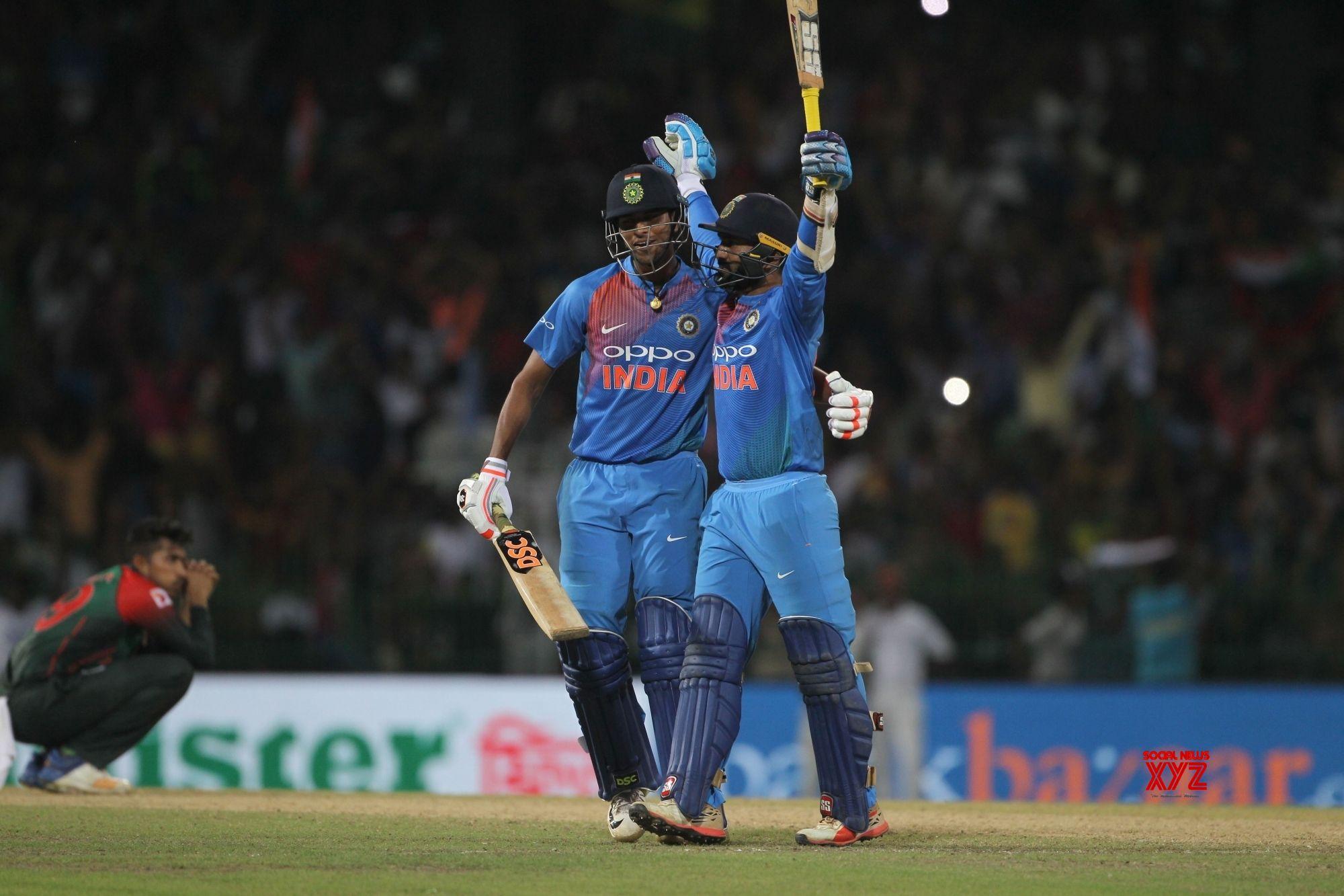 Colombo: Dinesh Karthik and Washington Sundar celebrate after winning 2018 Nidahas Twenty20 Tri-Series at R.Premadasa Stadium in Colombo, Sri Lanka on March 18, 2018. (Photo: Surjeet Yadav/IANS)