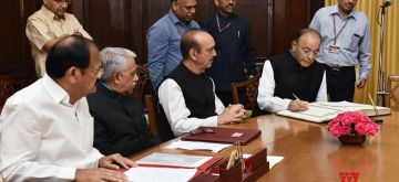 New Delhi: Vice President and Rajya Sabha Chairman M. Venkaiah Naidu administers the Oath of Office and Secrecy to the re-elected Member of Rajya Sabha and Union Finance and Corporate Affairs Minister Arun Jaitley, in New Delhi on April 15, 2018. (Photo: IANS/PIB)
