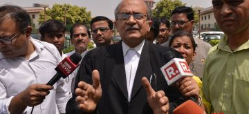 New Delhi: Advocate Prashant Bhushan talks to the press after the Supreme Court dismissed petition seeking SIT probe into the death of Judge Loya who was earlier holding trial in the Shorabuddin Sheikh staged shoot out case; in New Delhi on April 19, 2018. (Photo: IANS)