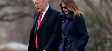 """WASHINGTON, March 19, 2018 (Xinhua) -- U.S. President Donald Trump (L) and First Lady Melania Trump depart the White House in Washington D.C., the United States, on March 19, 2018. U.S. President Donald Trump on Thursday suggested """"the ultimate penalties"""" against drug dealers in a bid to fight the country's rampant opioid crisis. (Xinhua/Ting Shen/IANS)"""