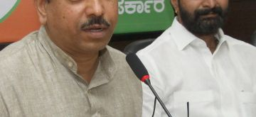 Karnataka BJP president Prahlad Joshi and party leader C T Ravi during a press conference in Bangalore on May 13, 2014. (Photo: IANS)