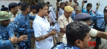 Muzaffarpur: A group of women blackened the face of Brajesh Thakur, the main accused in the Bihar shelter home horror case, while he was coming out of a district court where he was produced in connection with his involvement in the rape of 34 minor girls in the welfare facility, in Bihar's Muzaffarpur on Aug 8, 2018. (Photo: IANS)