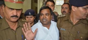 Lucknow:  Uttar Pradesh police arrest senior Samajwadi Party leader and gang rape accused Gayatri Prajapati in Lucknow on March 15, 2017. (Photo: IANS)