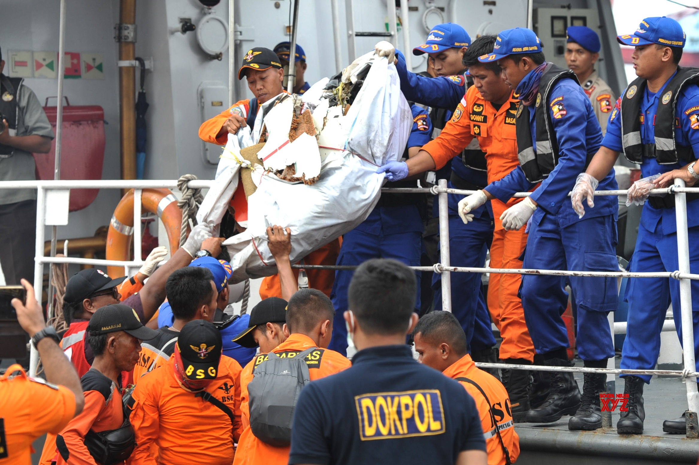 Indonesia widens search area for crashed plane wreckage, victims