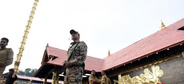"Pathanamthitta: A security personnel stands guard at the Sabarimala temple in Kerala's Pathanamthitta district on Nov 17, 2018. A Hindu group on Saturday called for a shutdown in Kerala following the ""detention"" of few religious leaders the previous night from the Sabarimala temple premises. The most prominent among the detained on Friday night were Hindu Iykavedi (HI) President and senior BJP leader K.P. Sasikala. She was detained while proceeding towards the Lord Ayyappa shrine. (Photo: IANS)"