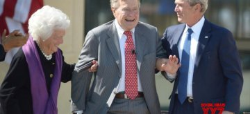 BEIJING, Dec. 1, 2018 (Xinhua) -- File photo taken on April 25, 2013 shows  former U.S. President George H. W. Bush(C) taking part in the unveiling ceremony of his son George W. Bush's presidential library in Dallas, the United States. George H.W. Bush, the 41st president of the United States, has died Friday at the age of 94, according to a statement from his office. (Xinhua/Xu Xun/IANS)