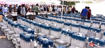 Jaipur: Polling officials wait in multiple queues to collect Electronic Voting Machines from a distribution center before leaving for their respective polling stations, on the eve of Rajasthan Assembly elections, in Jaipur on Dec 6, 2018. (Photo: Ravi Shankar Vyas/IANS)