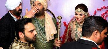 Jalandhar: Comedian Kapil Sharma and Ginni Chatrath at their wedding ceremony in Jalandhar on Dec. 12, 2018. (Photo: IANS)