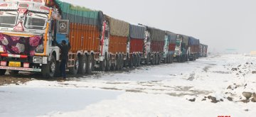 Srinagar: Trucks left stranded on Srinagar-Jammu highway after heavy snowfall led to the closure of the highway, on Jan 5, 2019. (Photo: IANS)