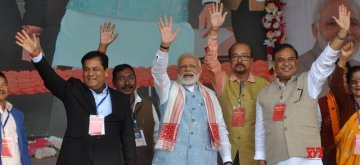 Sangsari: Prime Minister Narendra Modi along with Assam Chief Minister Sarbananda Sonowal and Finance Minister Himanta Biswa Sarma during a public rally in Assam's Sangsari,on Feb 9, 2019. (Photo: IANS)