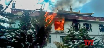 Kullu: Fire breaks out at a Dhakpo Shedrup Ling monastery in Kais village, around 10 km away from Himachal Pradesh's Kullu town on Feb 13, 2019. A part of the wooden Buddhist monastery opened by Tibetan spiritual leader the Dalai Lama was gutted in fire. (Photo: IANS)