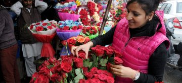 Amritsar: A lady selects roses on Valentine's Day in Amritsar, on Feb 14, 2019. (Photo: IANS)
