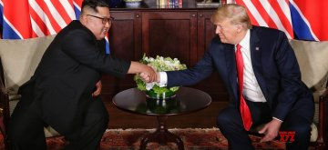 SINGAPORE, June 12, 2018 (Xinhua) -- Top leader of the Democratic People's Republic of Korea (DPRK) Kim Jong Un (L) meets with U.S. President Donald Trump in Singapore, on June 12, 2018. (Xinhua/Ministry of Communication and Information of Singapore/IANS)