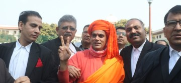 New Delhi: All India Hindu Mahasabha leader Swami Chakrapani Maharaj talks to media persons at Supreme Court in New Delhi on March 7, 2019. The Supreme Court on Friday ordered mediation to settle the Ram Janmabhoomi-Babri Masjid Ayodhya title dispute case by a three-member panel. (Photo: IANS)