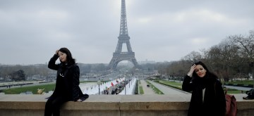 PARIS, March 25, 2019 (Xinhua) -- Visitors pose for photos with the Eiffel Tower in the background in Paris, France, on March 24, 2019. (Xinhua/Lan Hongguang/IANS)