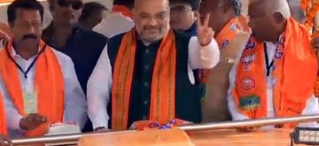 Tumakuru: BJP chief Amit Shah during a roadshow ahead of the 2019 Lok Sabha elections, in Karnataka's Tumakuru, on April 16, 2019. (Photo: IANS)