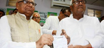 Patna: RJD leader Mangani Lal Mandal joins JD-U in the presence of Bihar party President Bashistha Narain Singh, in Patna on April 16, 2019. (Photo: IANS)