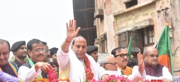 Lucknow: Union Minister and BJP's Lok Sabha candidate from Lucknow, Rajnath Singh with Uttar Pradesh Deputy Chief Minister Dinesh Sharma and BJP state President Mahendra Nath Pandey, during a roadshow ahead of filing his nomination papers for the forthcoming Lok Sabha elections, in Lucknow on April 16, 2019. (Photo: IANS)