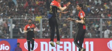 Kolkata: Royal Challengers Bangalore's players celebrate fall of a wicket during the 35th match of IPL 2019 between Kolkata Knight Riders and Royal Challengers Bangalore at Eden Gardens in Kolkata on April 19, 2019. (Photo: Kuntal Chakrabarty/IANS)