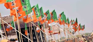 Nizamabad: BJP flags flutter in the air during a public meeting that was addressed by Prime Minister and party leader Narendra Modi in Nizamabad, Telangana on Nov 27, 2018. (Photo: IANS)