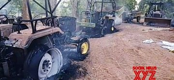Kalahandi: The construction vehicles that were set ablaze by Maoists in Odisha's Kalahandi, on May 15, 2019. (Photo: IANS)