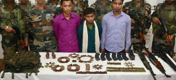 Tinsukia (Assam): Three cadres of United Liberation Front of Assam (Independent) identified as Bubul Moran alias Tiger Asom, Binondo Dahotia alias Swadesh Asom and Chandrakant Borhohain alias Tipong Asom who were arrested by the security forces along with sophisticated arms and ammunition, in Assam's Tinsukia district, on May 15, 2019. (Photo: IANS)