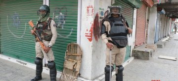 Srinagar: Security personnel stand guard as shops remain shut during a separatist-called protest shutdown over civilian deaths during an anti-terror operation, in Srinagar on May 17, 2019. (Photo: IANS)