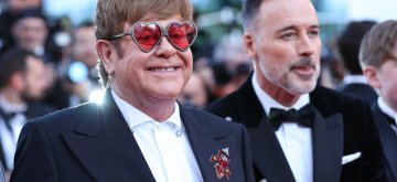 "CANNES, May 17, 2019 (Xinhua) -- Producer Elton John (L) poses on the red carpet for the premiere of the film ""Rocketman"" at the 72nd Cannes Film Festival in Cannes, France, on May 16, 2019. The 72nd Cannes Film Festival is held here from May 14 to 25. (Xinhua/Zhang Cheng/IANS)"