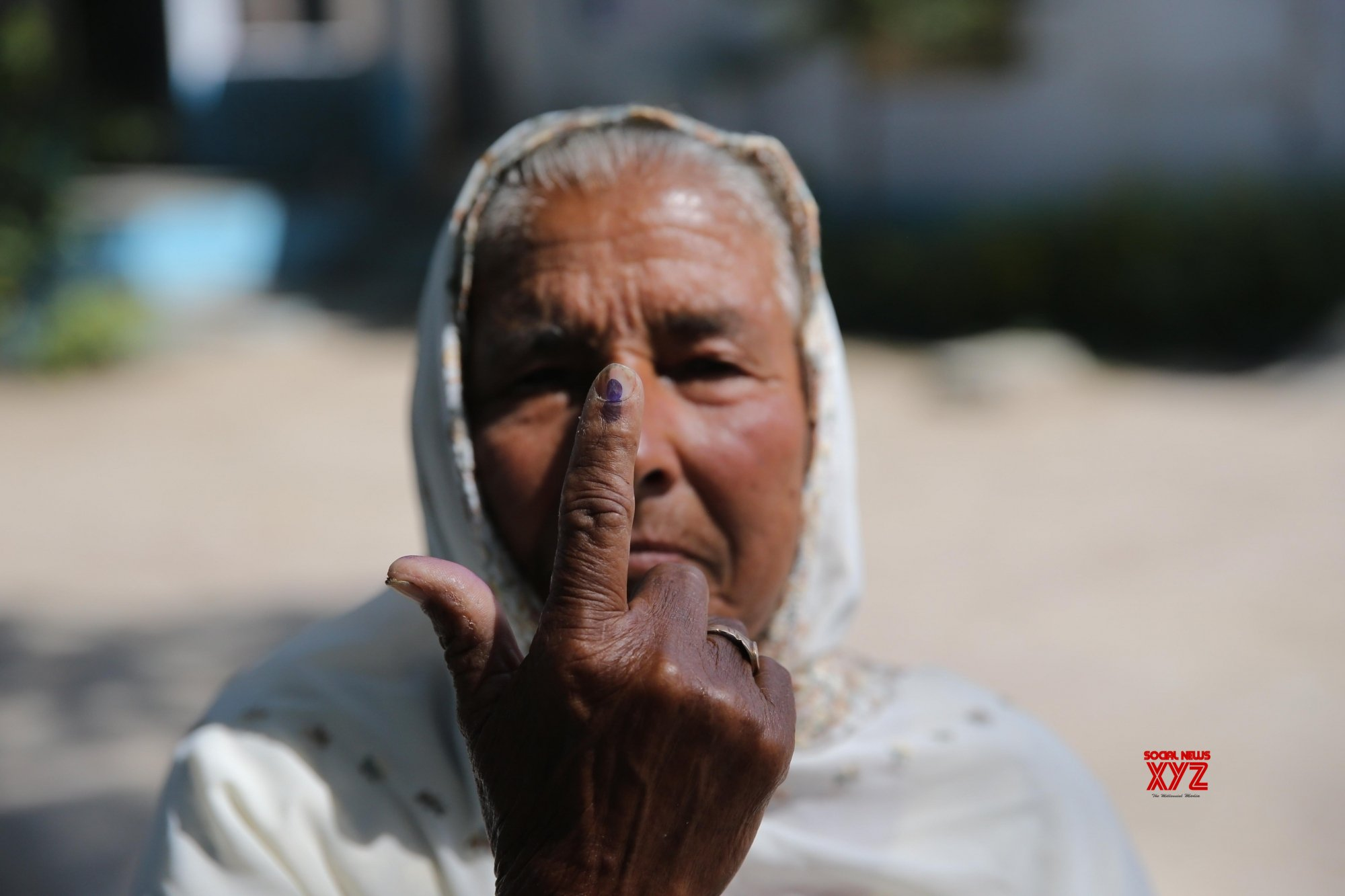 Amritsar: An elderly lady shows her forefinger marked with indelible ink after casting vote during the seventh and the last phase of 2019 Lok Sabha Elections at a polling booth in Amritsar on May 19, 2019. (Photo: IANS)