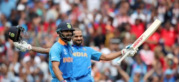 London: India's Shikhar Dhawan celebrates his century during the 14th match of 2019 World Cup between India and Australia at Kennington Oval in London on June 9, 2019. (Photo: Surjeet Yadav/IANS)