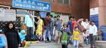 New Delhi: Unattended patients wait outside the OPD block of Loknayak Jayaprakash Narayan (LNJP) hospital where doctors went on a one day token strike and boycotted work to protest against the brutal assault on fellow medicos of West Bengal; in New Delhi on June 14, 2019. (Photo: IANS)