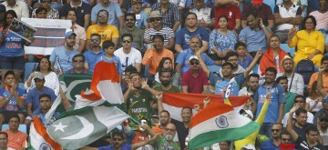 Dubai: Fans of India and Pakistan cheer for their respective teams during the third match of Asia Cup 2018 Super Four between India and Pakistan at Dubai International Cricket Stadium in Dubai, UAE on Sept 23, 2018. (Photo: Surjeet Yadav/IANS)