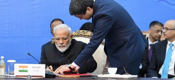 Bishkek: Prime Minister Narendra Modi signs documents at the 2019 Shanghai Cooperation Organization (SCO) Summit in Bishkek, Kyrgyzstan on June 14, 2019. (Photo: IANS/PIB)