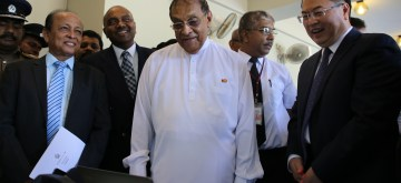 COLOMBO, June 19, 2019 (Xinhua) -- Speaker of Sri Lankan Parliament Karu Jayasuriya (C) and Chinese Ambassador to Sri Lanka Cheng Xueyuan (1st R) look at security equipment at Sri Lankan Parliament on June 19, 2019. China on Wednesday donated a batch of security equipment to the Sri Lankan Parliament to ensure the safety of the public and legislators following the recent terror attacks in the island country. (Xinhua/Zhu Ruiqing/IANS)
