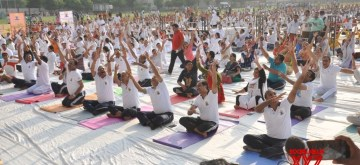 Aligarh: Students practice yoga asanas - postures - on the 5th International Yoga Day at Aligarh Muslim University, on June 21, 2019. The week long yoga day celebrations at AMU, climaxed on Friday, with a mass yoga exercise session.(Photo: IANS)