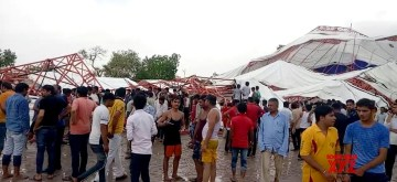 Barmer: People gathered at the site where a massive tent erected for people attending a religious gathering collapsed during a dust storm in Rajasthan's Barmer, on June 23, 2019. Around 11 people died and many were injured. (Photo: IANS)
