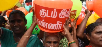 Chennai: Locals along with DMK workers participate in a protest march carrying empty pots to press for a solution to Chennai's water crisis, on June 24, 2019. On Saturday, the DMK held protests at all the district headquarters to press the government to mitigate people's suffering in the parched state. (Photo: IANS)