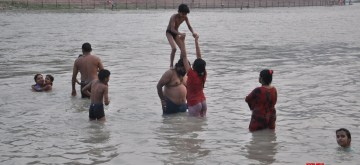 Haridwar: People beat the heat in the Ganga river in Haridwar on July 1, 0199. (Photo: IANS)