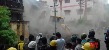 Indore: The building that was stopped from being demolished by Akash Vijayavargiya, son of BJP's National General Secretary Kailash Vijayavargiya, being razed by the Municipal Corporation in Indore, Madhya Pradesh on July 5, 2019. On June 26, Akash had beaten up a municipal corporation officer with a cricket bat and a video of the incident went viral on social media. The officer was on-duty and had gone to demolish an unsafe building. (Photo: IANS)