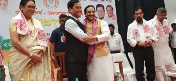 Guwahati: Union Minister Ramesh Pokhriyal being greeted by Assam Chief Minister Sarbananda Sonowal at the launch of BJP Membership drive, in Guwahati on July 6, 2019. (Photo: IANS)
