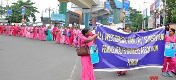 Kolkata: Members of All West Bengal ANM (R)/ Supervisor Female Health Workers Association Forum stage a demonstration against the State Government to press for their various demands, in Kolkata on July 10, 2019. (Photo: Kuntal Chakrabarty/IANS)