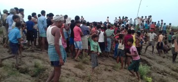 Lakhisarai: People gather at the site where a boat accident took place at Qul Ghat in Lakhisarai, Bihar on July 10, 2019. (Photo: IANS)