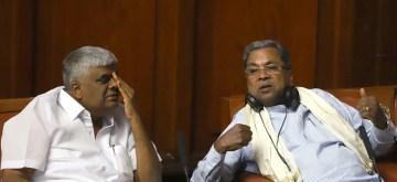 Bengaluru: Congress legislators Siddaramaiah and H. D. Revanna during Karnataka Assembly session at  Vidhana Soudha in Bengaluru on July 12, 2019. (Photo: IANS)